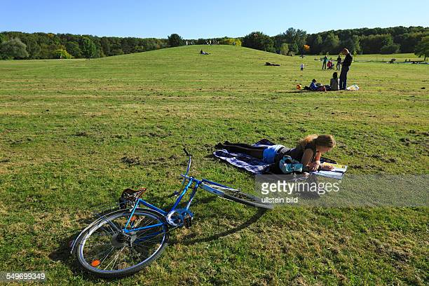 Cologne-Rodenkirchen, Friedenswald, nearby recreational area, lawn for sunbathing, young girl, bicycle