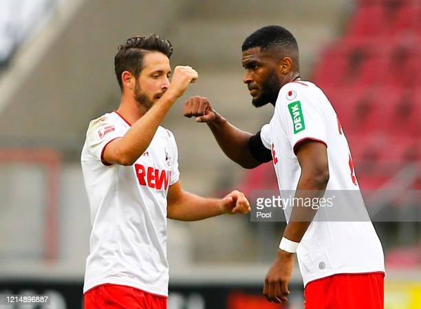Cologne's Anthony Modeste celebrates scoring their first goal with Mark Uth during the Bundesliga match between 1. FC Koeln and Fortuna Duesseldorf...