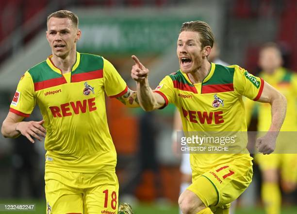 Cologne's Austrian midfielder Florian Kainz celebrates scoring the 0-2 goal with his team-mate Cologne's Slovak midfielder Ondrej Duda during the...