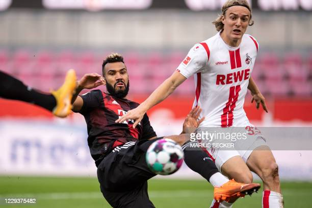 Cologne's Belgian defender Sebastiaan Bornauw and Bayern Munich's Cameroonian forward Eric Maxim ChoupoMoting vie for the ball during the German...