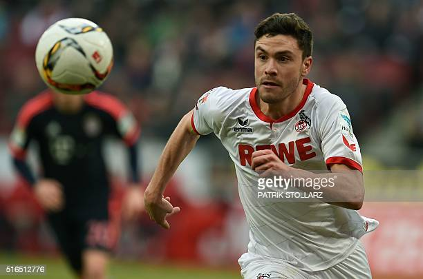 Cologne's defender Jonas Hector runs with the ball during the German Bundesliga first division football match between FC Cologne vs FC Bayern Munich...