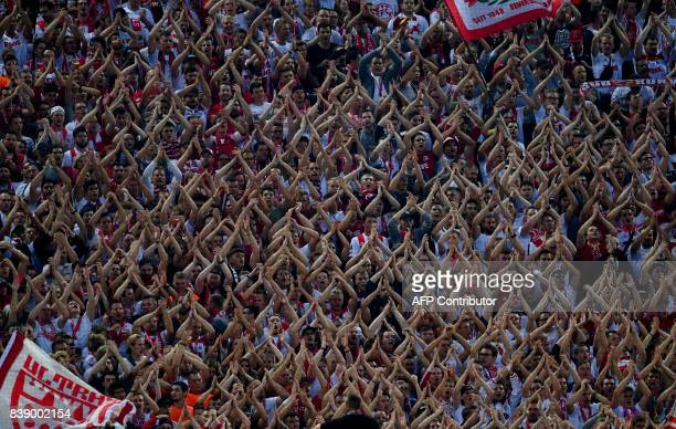 Cologne's fans applaud prior to the German first division Bundesliga football match 1 FC Cologne v Hamburg SV in Cologne western Germany on August 25...