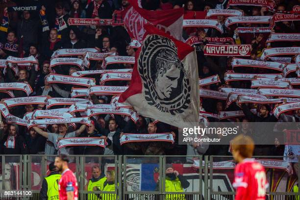 FC Cologne's fans support their team during the UEFA Europa League Group H football match between FC BATE Borisov and FC Cologne in Borisov outside...