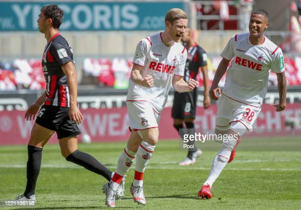 Cologne's Florian Kainz celebrates after scoring his sides first goal from the penalty spot next to Jonathan de Guzman of Frankfurt and Cologne's...
