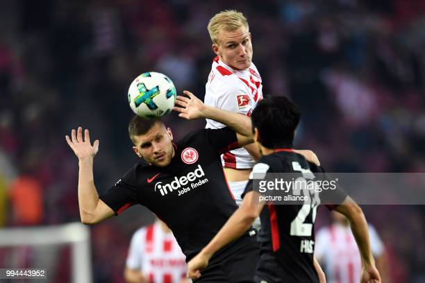 Cologne's Frederik Soerensen and Frankfurt's Ante Rebic vie for the ball during the German Bundesliga soccer match between 1 FC Cologne and Eintracht...