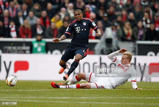 Cologne's Frederik Soerensen in action against Bayern Munich's Douglas Costa during the Bundesliga football match between 1 FC Cologne and Bayern...