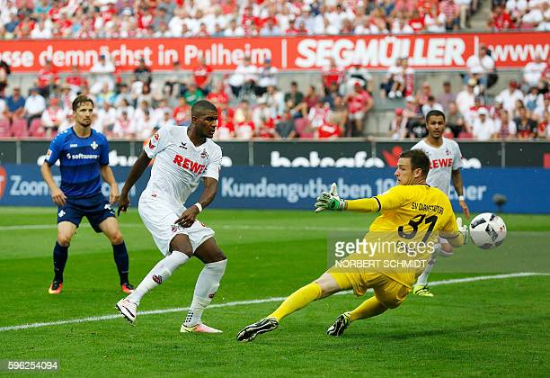 Cologne's French forward Anthony Modeste scores the 2-0 against Darmstadt's goalkeeper Michael Esser during the German first division Bundesliga...