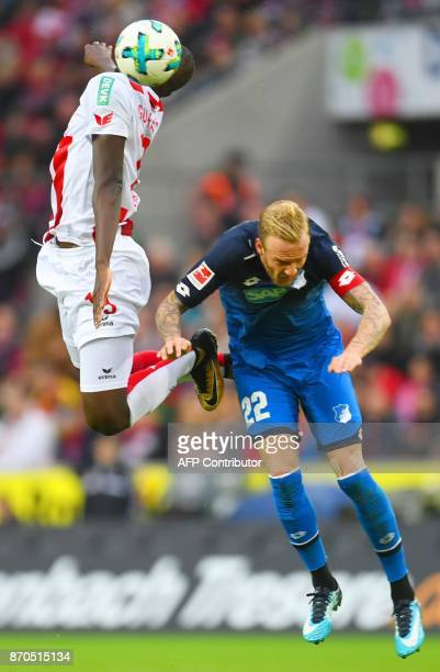 Cologne's French forward Sehrou Guirassy and Hoffenheim's German midfielder Kevin Vogt vie for the ball during the German first division Bundesliga...