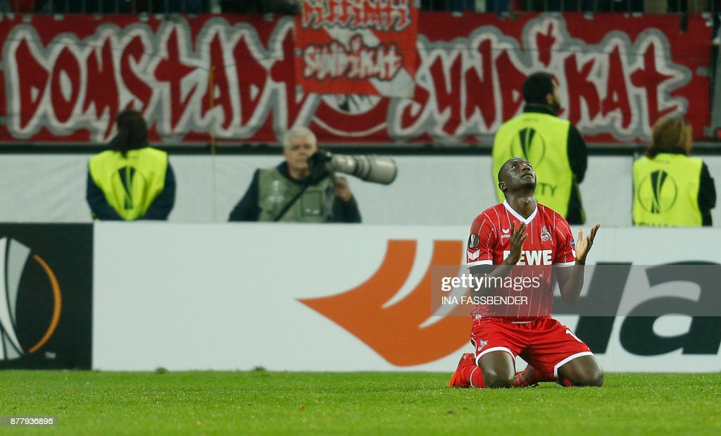 Cologne's French forward Sehrou Guirassy (R) celebrates scoring a penalty during the UEFA Europa League football match 1 FC Cologne v Arsenal FC on November 23, 2017 in Cologne, western Germany. /
