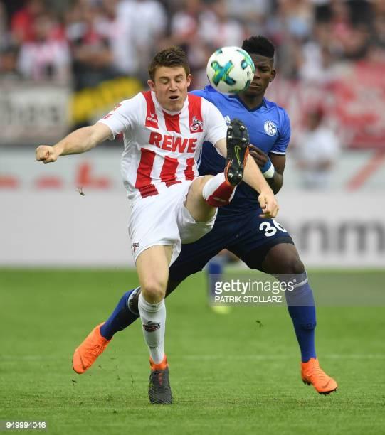 Cologne's German defender Dominique Heintz and Schalke's US midfielder Weston McKennie vie for the ball during the German first division Bundesliga...
