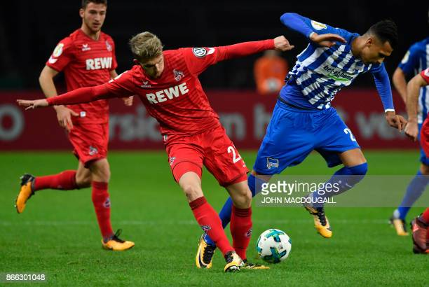 Cologne's German defender Jannes Horn and Berlin's German forward Davie Selke vie for the ball during the German Cup football match Hertha Berlin v 1...