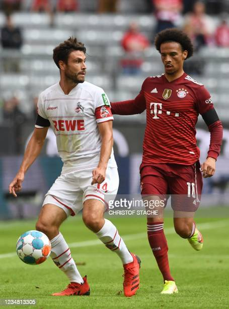 Cologne's German defender Jonas Hector and Bayern Munich's German midfielder Leroy Sane vie for the ball during the German first division Bundesliga...