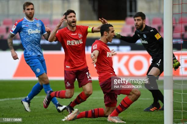 Cologne's German defender Jonas Hector and Cologne's Tunisian midfielder Ellyes Skhiri react after missing a chance during the German relegation...