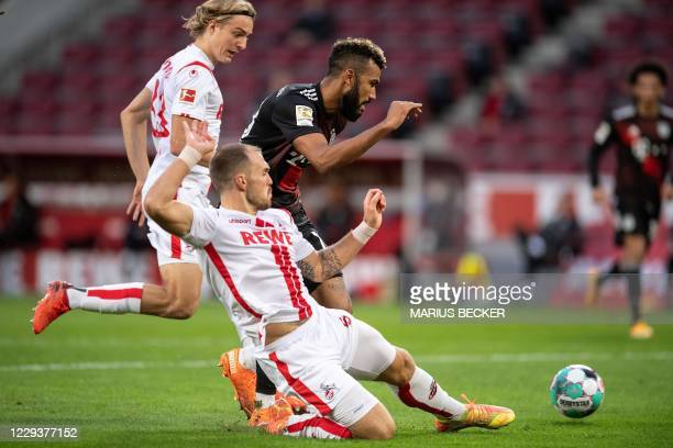 Cologne's German defender Rafael Czichos and Bayern Munich's Cameroonian forward Eric Maxim ChoupoMoting vie for the ball during the German first...