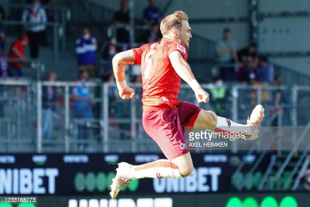 Cologne's German defender Rafael Czichos celebrates scoring the 1-4 goal during the German second leg play-off relegation Bundesliga football match...