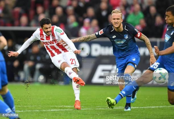 Cologne's German midfielder Leonardo Bittencourt and Hoffenheim's German midfielder Kevin Vogt vie for the ball during the German first division...