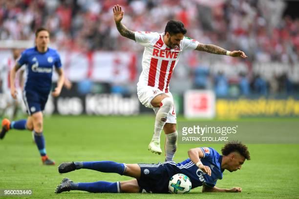 Cologne's German midfielder Leonardo Bittencourt and Schalke's German defender Thilo Kehrer vie for the ball during the German first division...
