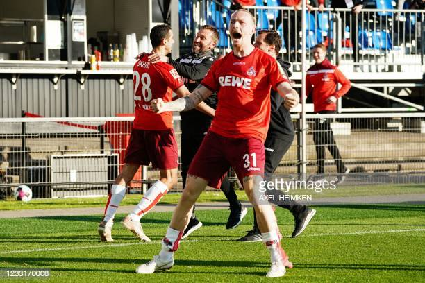 Cologne's German midfielder Marius Wolf celebrates after Cologne's Tunisian midfielder Ellyes Skhiri celebrates scored the 1-5 goal during the German...