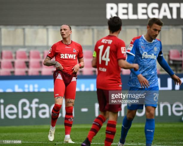 Cologne's German midfielder Marius Wolf reacts during the German relegation Bundesliga football match between first division team 1 FC Cologne and...