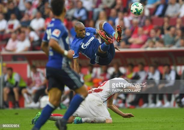 Cologne's German midfielder Simon Terodde and Schalke's Brazilian defender Naldo vie for the ball during the German first division Bundesliga...
