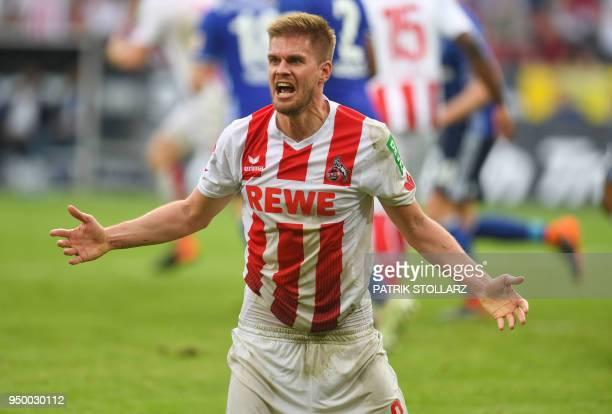 Cologne's German midfielder Simon Terodde reacts during the German first division Bundesliga football match FC Cologne vs Schalke 04 in Cologne...
