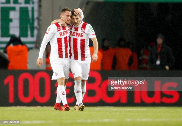 Cologne's goal scorer 10 Christian Clemens celebrates with his team mate Milos Jojicc during the German Bundesliga soccer match between 1 FC Colgne...