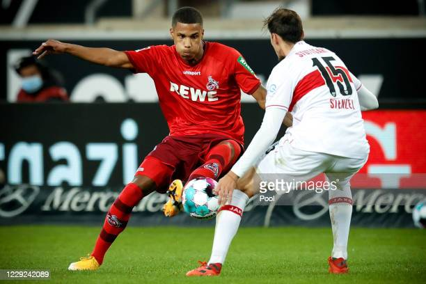 Cologne's Ismail Jakobs in action against Stuttgart's Pascal Stenzel during the Bundesliga match between VfB Stuttgart and 1. FC Koeln at...