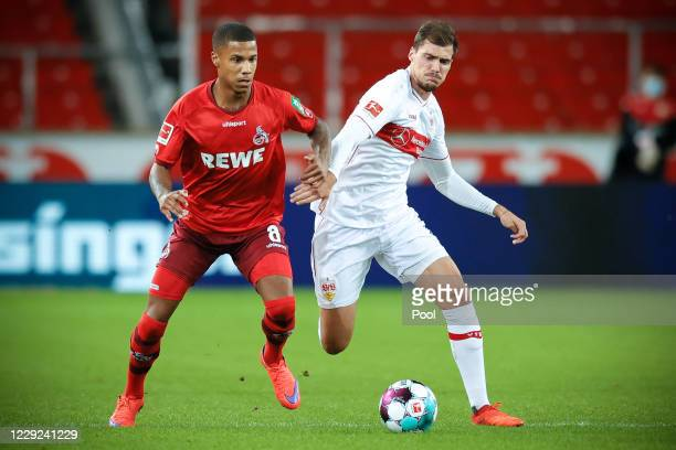 Cologne's Ismail Jakobs in action against Stuttgart's Sasa Kalajdzic during the Bundesliga match between VfB Stuttgart and 1. FC Koeln at...