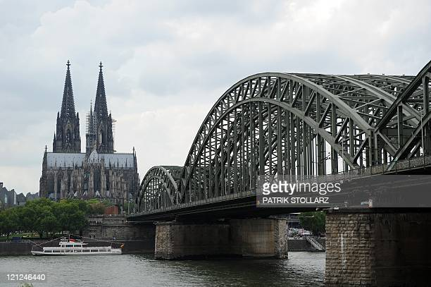 Cologne's landmark the Cologne Cathedral and the Hohenzollernbruecke Bruecke bridge over the Rhine river are pictured on August 15 2011 AFP PHOTO /...