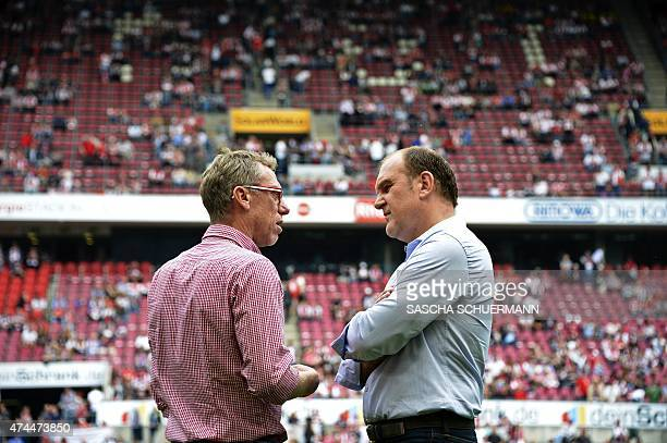 Cologne's Manager Joerg Schadtke talks to Cologne's Headcoach Peter Stoeger prior German first division Bundesliga football match 1 FC Cologne vs VfL...