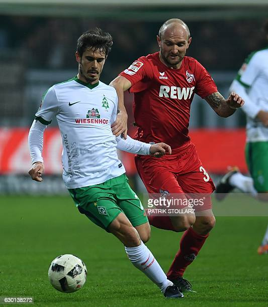 Cologne's midfielder Konstantin Rausch and Bremen's midfielder Fin Bartels vie for the ball during the German first division Bundesliga football...