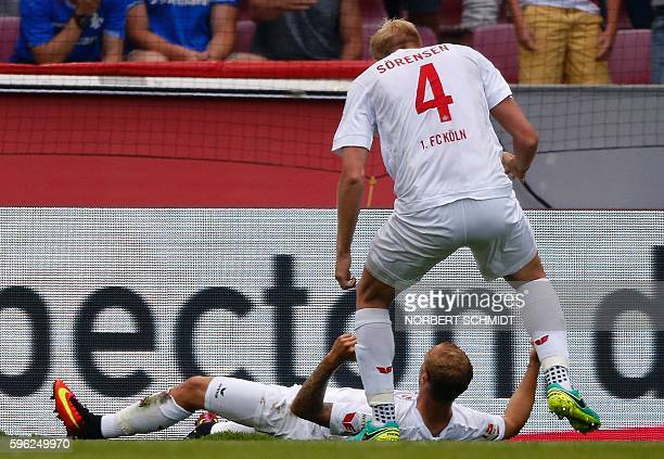 Cologne's midfielder Marcel Risse is congratulated by Cologne's Danish defender Frederik Soerensen after scoring during the German first division...