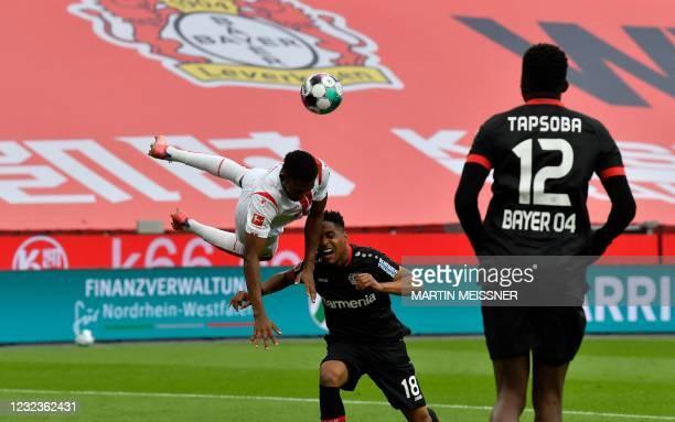 Cologne's Nigerian forward Emmanuel Dennis and Leverkusen's Brazilian defender Wendell vie for the ball during the German first division Bundesliga...