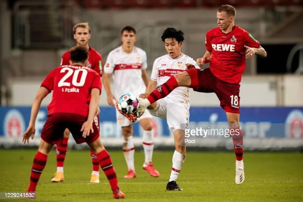Cologne's Ondrej Duda in action against Stuttgart's Wataru Endo during the Bundesliga match between VfB Stuttgart and 1. FC Koeln at Mercedes-Benz...