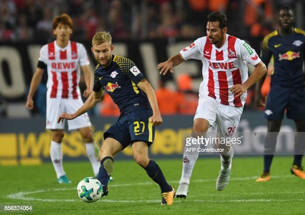 Cologne´s Peruvian striker Claudio Pizarro and Leipzig´s striker Konrad Laimer vie for the ball during the German First division Bundesliga football...