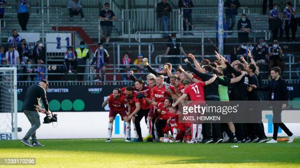 Cologne's players pose for a team photo after their 1-5 win during the German second leg play-off relegation Bundesliga football match between second...