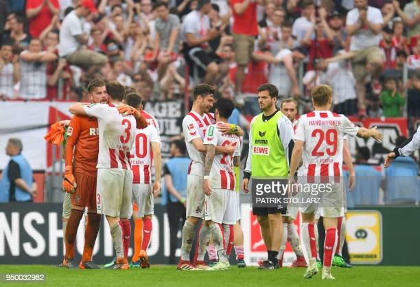 Cologne's players react after the German first division Bundesliga football match FC Cologne vs Schalke 04 in Cologne western Germany on April 22...