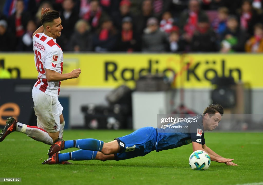 Cologne's Polish defender Pawel Olkowski (L) and Hoffenheim's German forward Mark Uth vie for the ball during the German first division Bundesliga football match FC Cologne vs 1899 Hoffenheim in Cologne, western Germany, on November 5, 2017. /