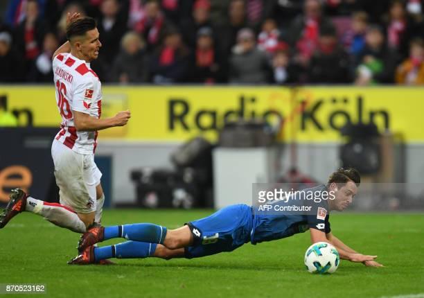 Cologne's Polish defender Pawel Olkowski and Hoffenheim's German forward Mark Uth vie for the ball during the German first division Bundesliga...