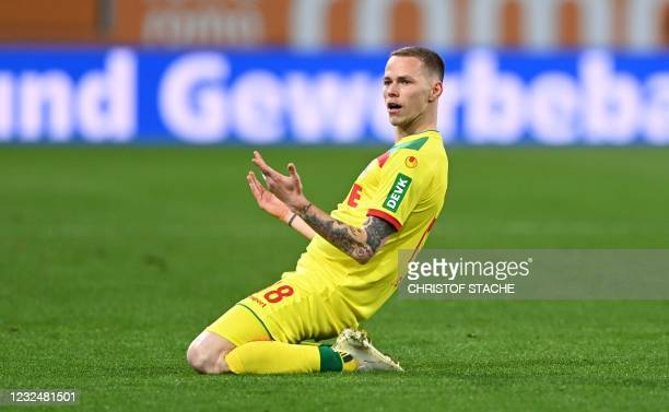 Cologne's Slovak midfielder Ondrej Duda celebrates scoring the opening goal during the German first division Bundesliga football match between FC...