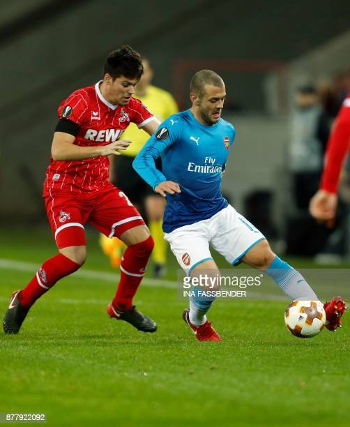 Cologne's Spanish defender Jorge Mere and Arsenal's English midfielder Jack Wilshere vie for the ball during the UEFA Europa League football match 1...