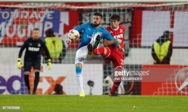 Cologne's Spanish defender Jorge Mere and Arsenal's Olivier Giroud vie for the ball during the UEFA Europa League football match 1 FC Cologne v...