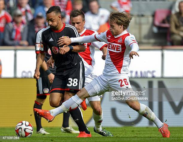Cologne's striker Bard Finne vies for the ball with Leverkusen's forward Karim Bellarabi during the German first division Bundesliga football match...