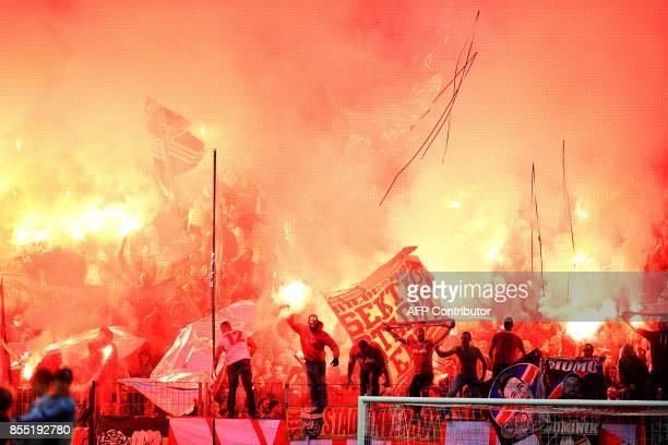 Cologne´s supporters light flares during the UEFA Europa League group H football match between FC Cologne and FC Crvena Zvezda Beograd in Cologne...