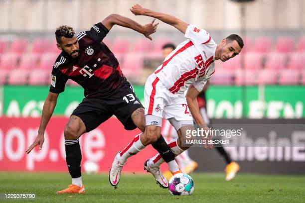 Cologne's Tunisian midfielder Ellyes Skhiri and Bayern Munich's Cameroonian forward Eric Maxim ChoupoMoting vie for the ball during the German first...