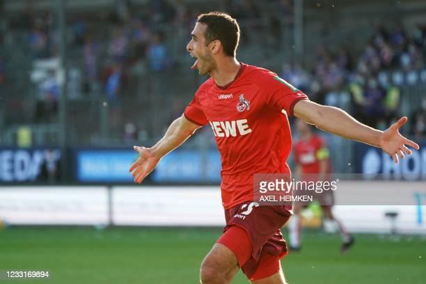 Cologne's Tunisian midfielder Ellyes Skhiri celebrates scoring the 1-5 goal during the German second leg play-off relegation Bundesliga football...