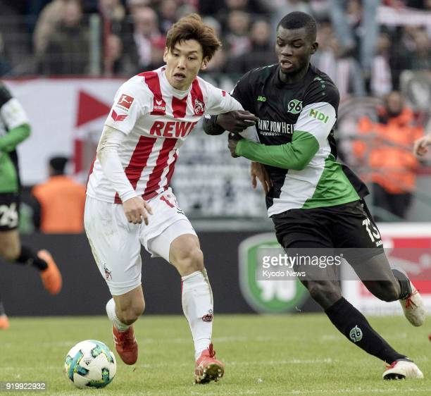 Cologne's Yuya Osako and Hannover's Ihlas Bebou vie for the ball during the second half of a 11 Bundesliga match draw in Cologne on Feb 17 2018...