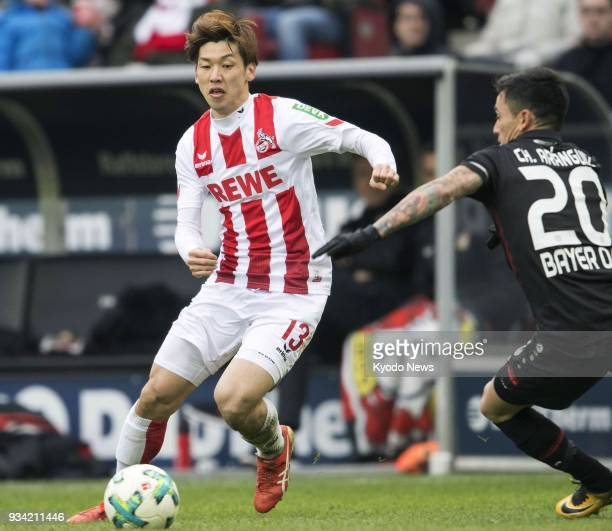 Cologne's Yuya Osako attempts to evade Bayer Leverkusen's Charles Aranguiz during the second half of Cologne's 20 win at home in the German...
