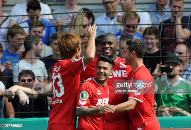 Cologne's Yuya Osako goal scorer Anthony Modeste Leonardo Bittencourt and Jonas Hector celebrate the goal at 10 during the DFB cup first round match...