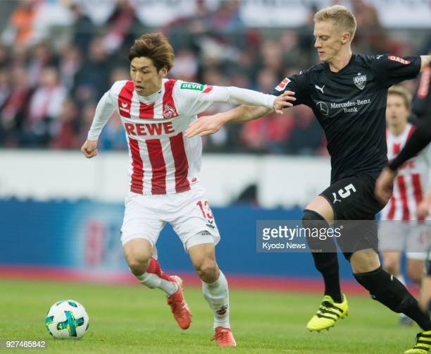 Cologne's Yuya Osako vies for the ball with Stuttgart's Timo Baumgartl at a match in Cologne Germany on March 4 2018 Stuttgart won 32 ==Kyodo